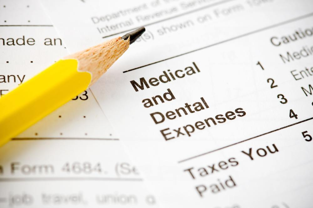 Dental Insurance Midwest City OK | a picture of a pencil on top of financing papers