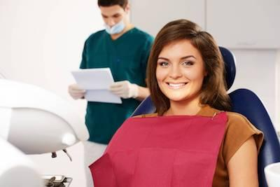 gum treatments midwest city ok | a woman smiling in the dental chair