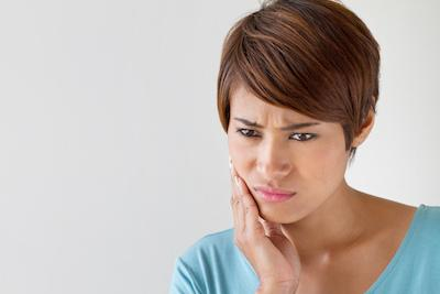 Emergency Dentistry in Midwest City | A Woman Holds Her Jaw In Pain