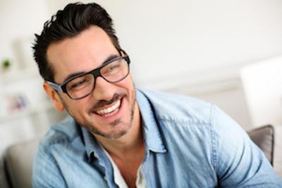 midwest city ok teeth extractions | a man with glasses smiling