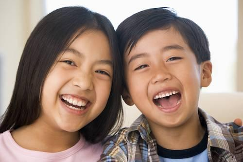 midwest city ok preventive dental treatment | two children laugh together